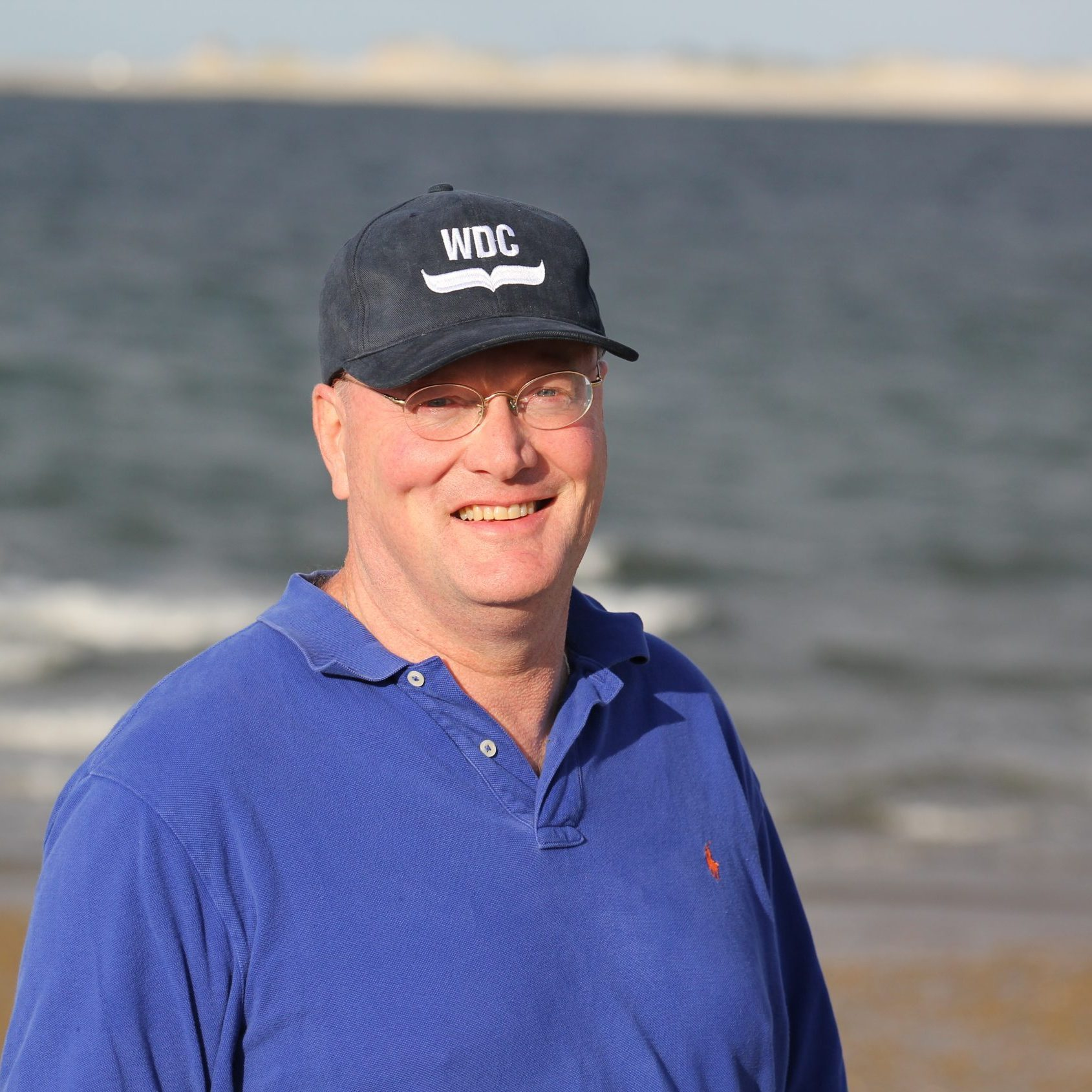 Philanthropy Officer Douglas Lovell standing on beach in Plymouth, MA